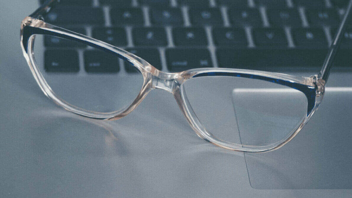image showing reading glasses on laptop