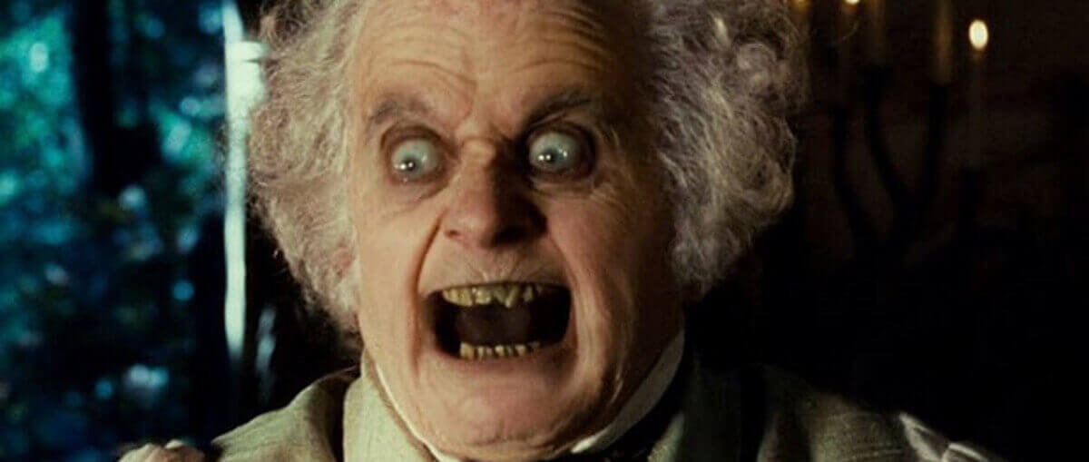 image showing bilbo baggins with a scary face ring from lord of the rings