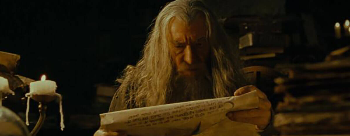 gandalf reading a scroll