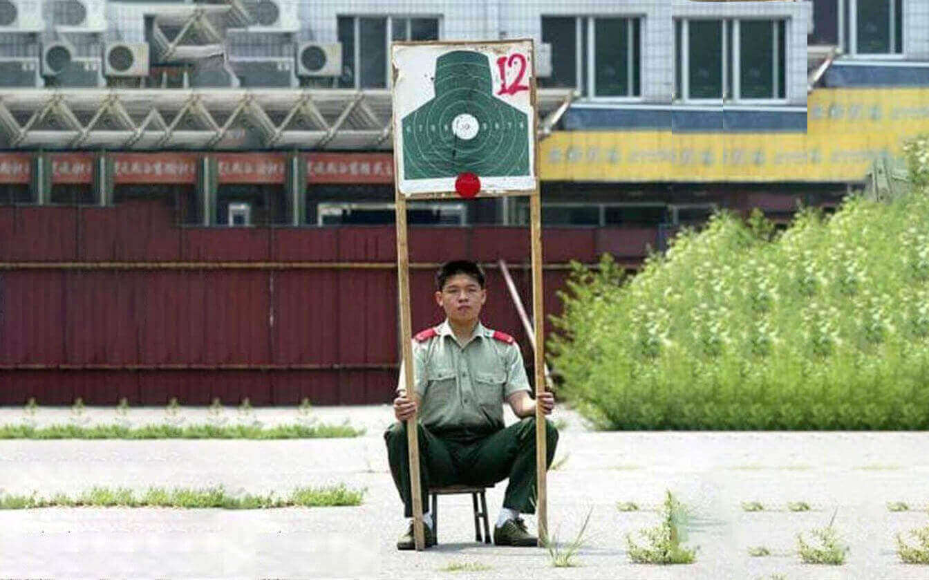 image showing north korean soldier holding a target